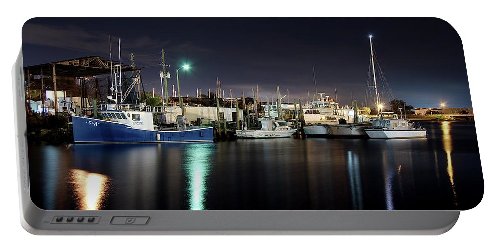 Tarpon Springs Portable Battery Charger featuring the photograph The Docks At Night by Bryan Goebert