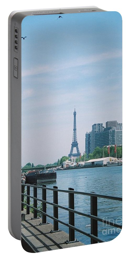 The Eiffel Tower Portable Battery Charger featuring the photograph The Eiffel Tower And The Seine River by Nadine Rippelmeyer