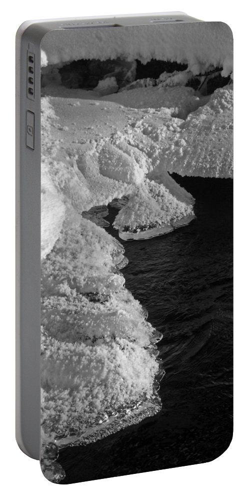 North America Portable Battery Charger featuring the photograph The First Ice by Juergen Weiss