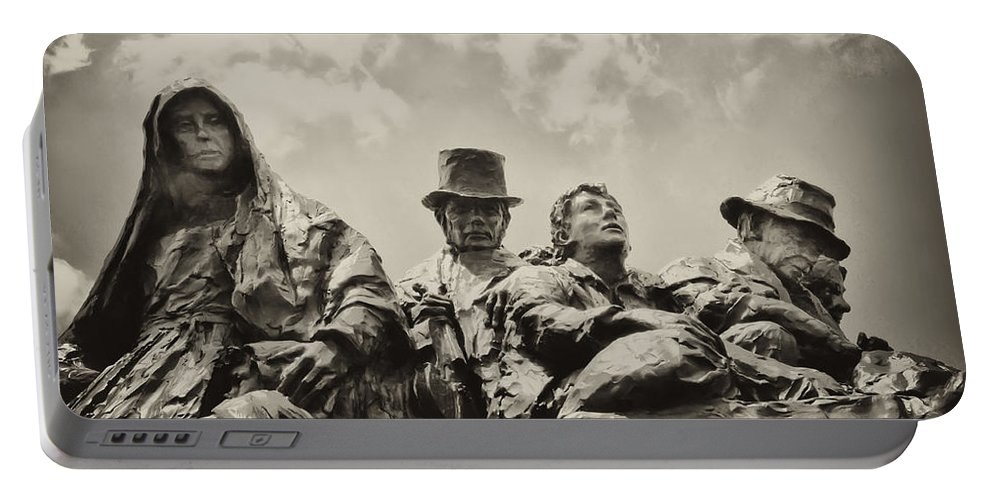 Philadelphia Portable Battery Charger featuring the photograph The Irish Emigration by Bill Cannon