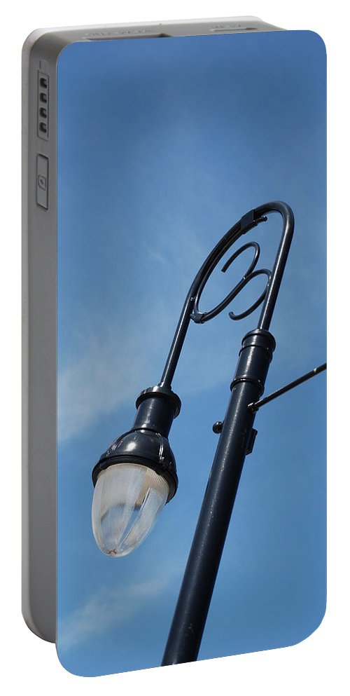 Blue Sky Portable Battery Charger featuring the photograph The Lamp Post by Rob Hans