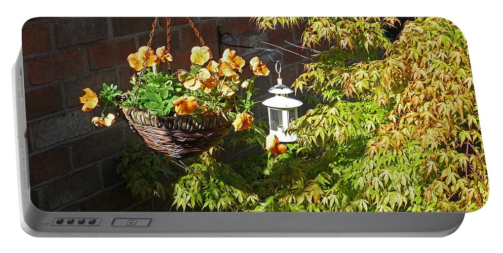 Hanging Basket Portable Battery Charger featuring the photograph The Lantern by Charles Stuart