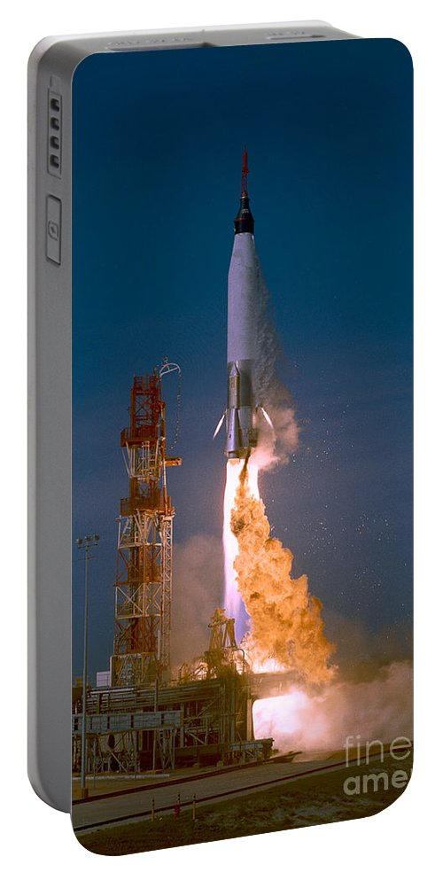 Mercury Portable Battery Charger featuring the photograph The Launch Of The Mercury Atlas by Stocktrek Images