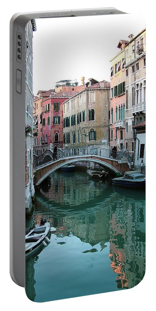 Landscape Portable Battery Charger featuring the photograph The Leaning Boat by Donna Corless
