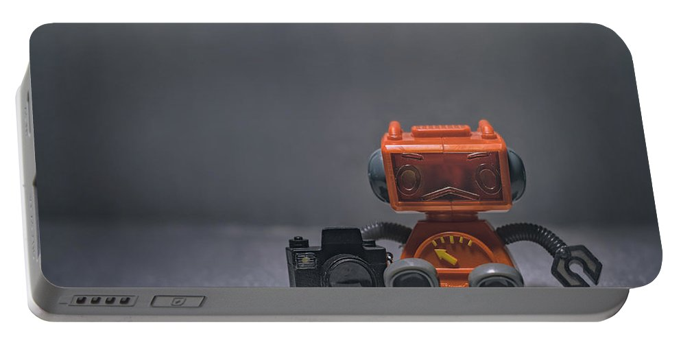 Toy Robot Portable Battery Charger featuring the photograph The Lonely Robot Photographer by Scott Norris