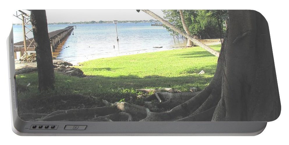 Florida Portable Battery Charger featuring the photograph The Long Dock by Ian MacDonald