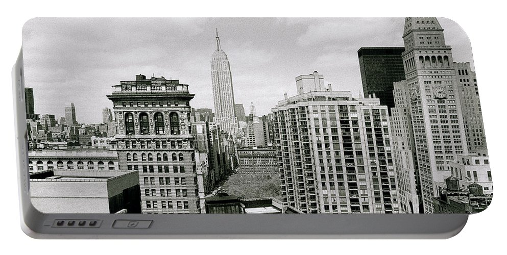 New York Portable Battery Charger featuring the photograph The New York Skyline by Shaun Higson