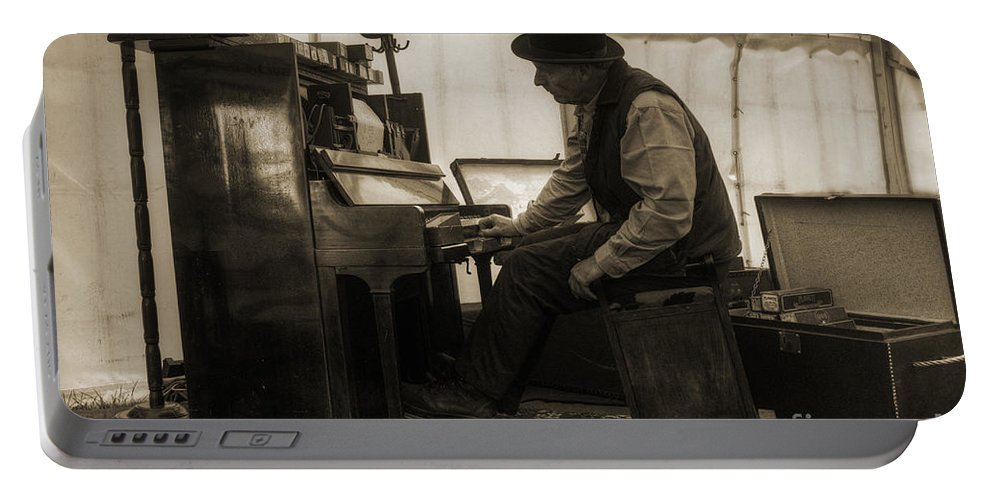 Piano Portable Battery Charger featuring the photograph The Pianist by Rob Hawkins