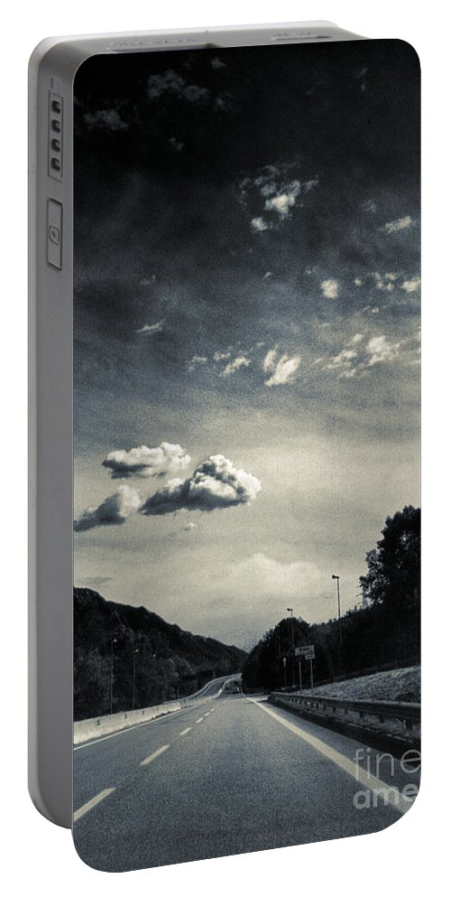 Road Portable Battery Charger featuring the photograph The Road And The Clouds by Silvia Ganora
