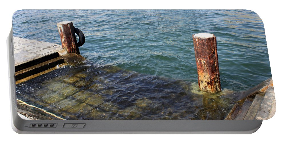 Sea Portable Battery Charger featuring the photograph The Separation by Munir Alawi