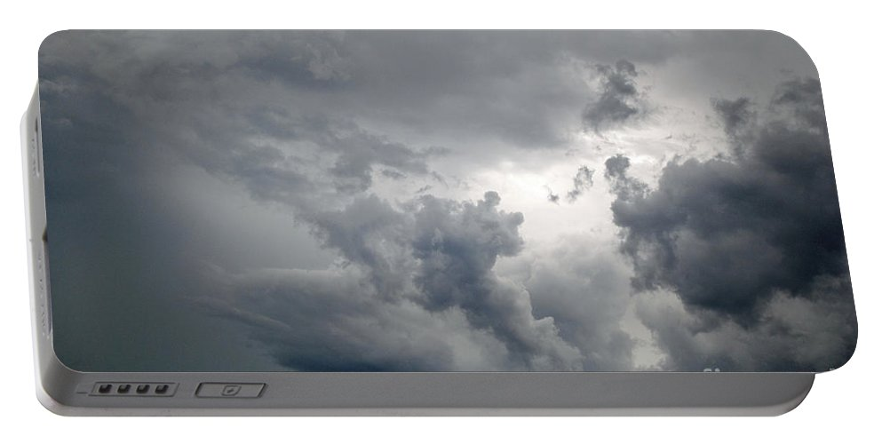 Clouds Portable Battery Charger featuring the photograph The Storm by Jost Houk
