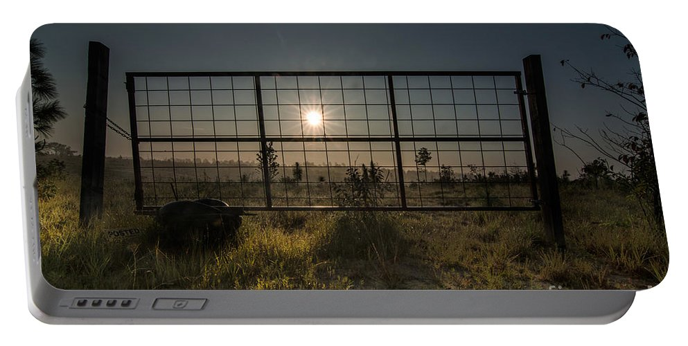 Sun Portable Battery Charger featuring the photograph The Sun Is Free by James Hennis