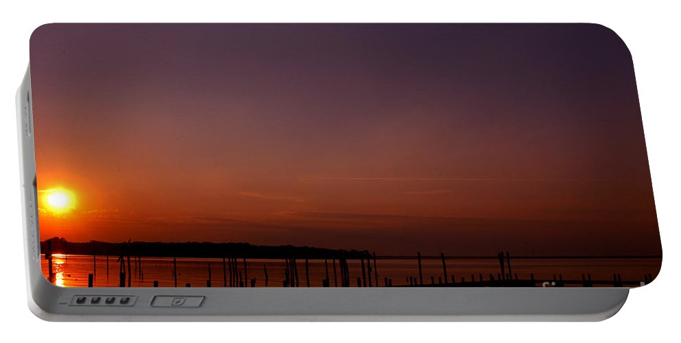 Clay Portable Battery Charger featuring the photograph The Sun Sets Over The Water by Clayton Bruster