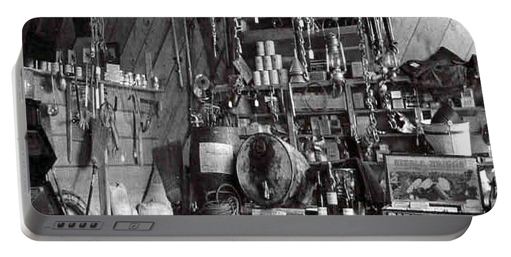 Classic Black And White Old Photo Pioneers Old Days 1900s Old Store Supplies Hardware Portable Battery Charger featuring the photograph The Supply Store by Andrea Lawrence