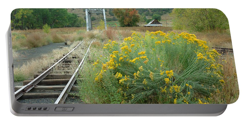 Train Portable Battery Charger featuring the photograph The Tracks At Pagosa Junction by Jerry McElroy