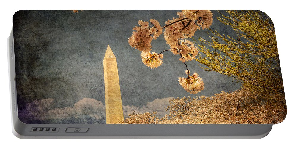 Washington Portable Battery Charger featuring the photograph The Washington Monument by Lois Bryan