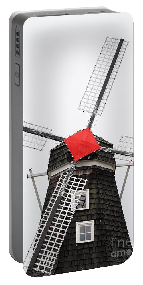 Dutch Portable Battery Charger featuring the photograph The Windmill by Jost Houk