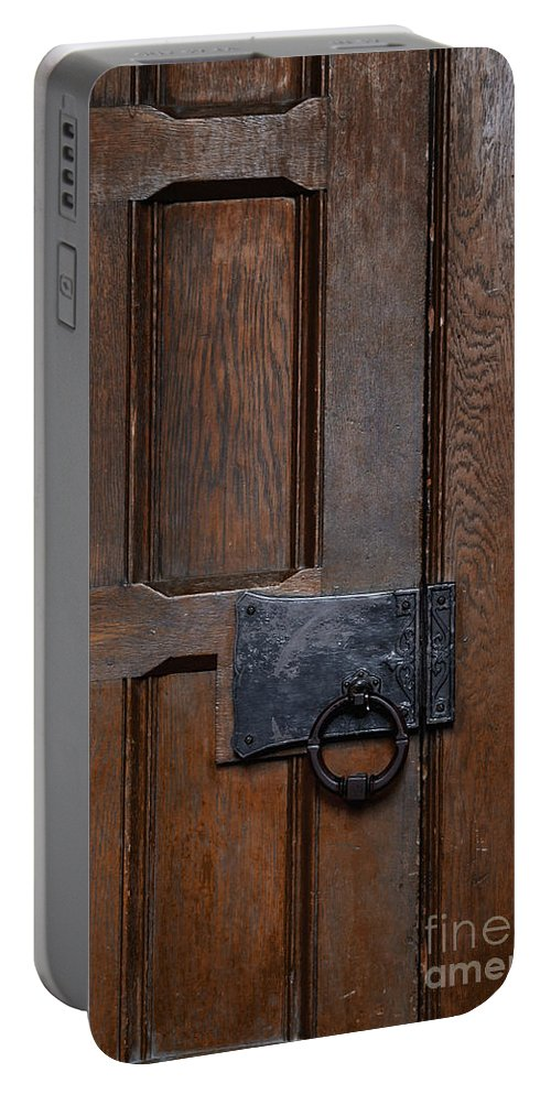Door Portable Battery Charger featuring the photograph The Wrought Iron Handle by Margie Hurwich