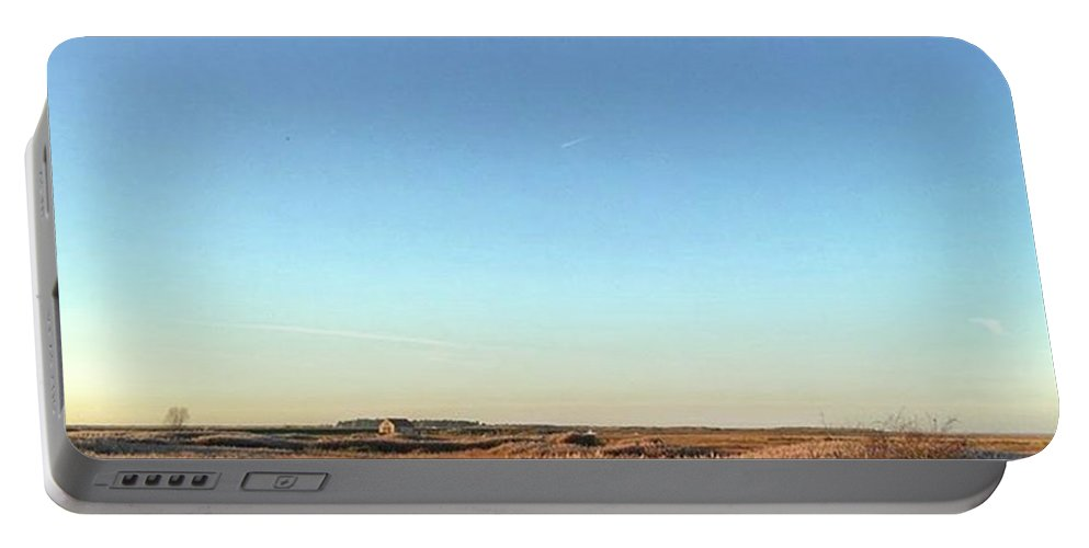 Natureonly Portable Battery Charger featuring the photograph Thornham Marsh Lit By The Setting Sun by John Edwards