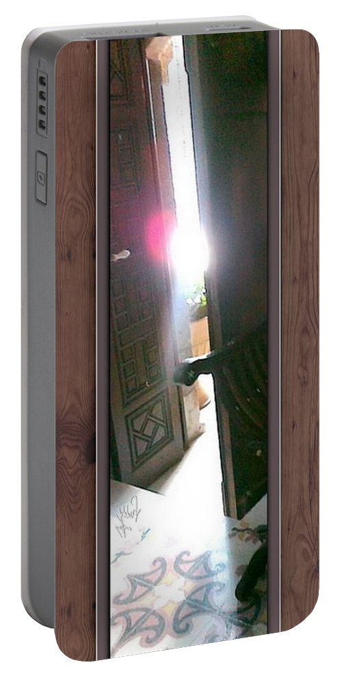Light Portable Battery Charger featuring the photograph Through The Mirror by Freddy Kirsheh
