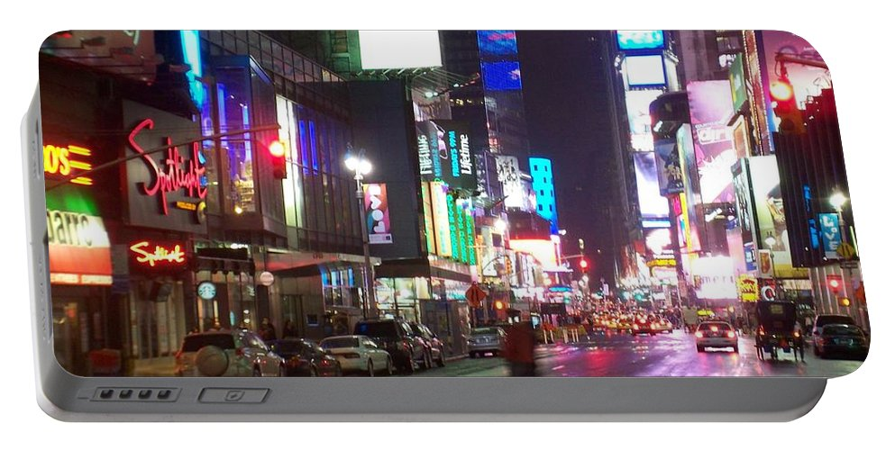 Times Square Portable Battery Charger featuring the photograph Times Square in the rain 2 by Anita Burgermeister