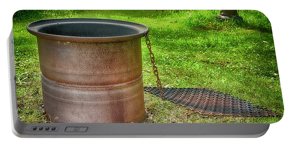 Campsite Portable Battery Charger featuring the photograph Tire Rim Fire Pit by Justin Mountain