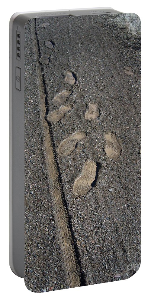 Prescott Portable Battery Charger featuring the photograph Tire Tracks And Foot Prints by Heather Kirk