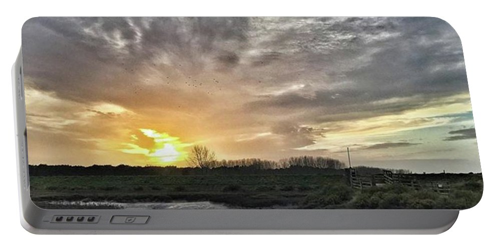 Natureonly Portable Battery Charger featuring the photograph Tonight's Sunset From Thornham by John Edwards