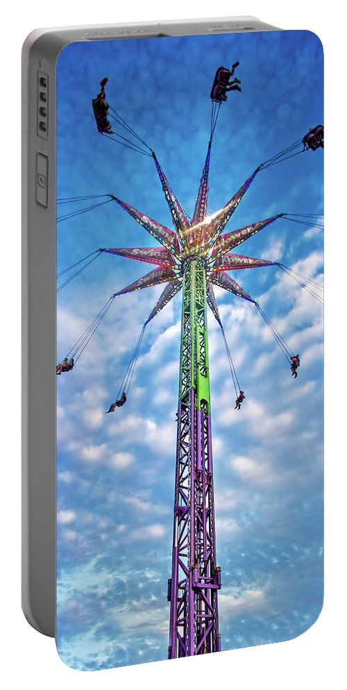 Carnival Portable Battery Charger featuring the photograph Touch The Sky by Mark Andrew Thomas