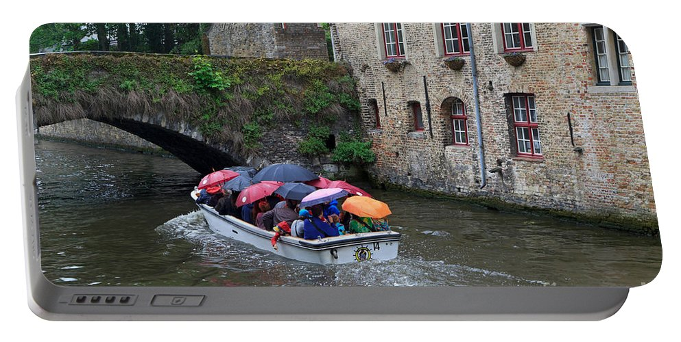 Tourists Portable Battery Charger featuring the photograph Tourists With Umbrellas In A Sightseeing Boat On The Canal In Bruges by Louise Heusinkveld