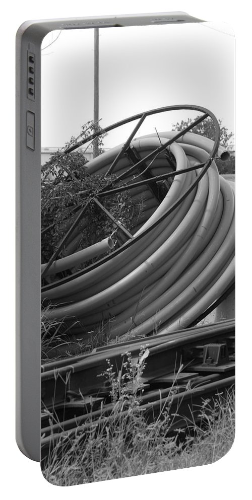 Blacka Nd White Portable Battery Charger featuring the photograph Tracks And Cable by Rob Hans