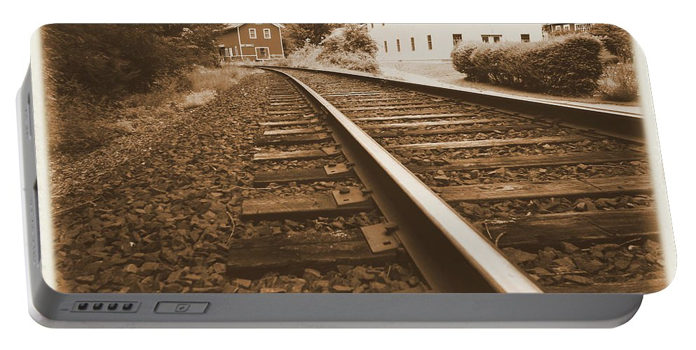 Landscape Portable Battery Charger featuring the photograph Tracks To Town by Karol Livote