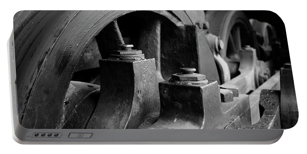Black And White Portable Battery Charger featuring the photograph Trainwheels by Jeff Greene