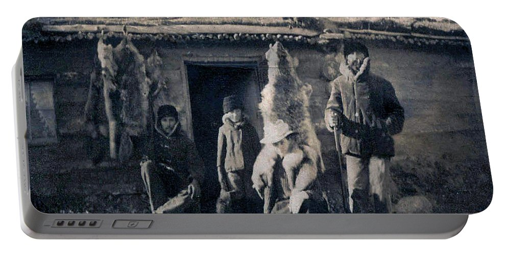 Old Photo Black And White Classic Saskatchewan Pioneers History Trappers Furs Amimals Portable Battery Charger featuring the photograph Trappers by Andrea Lawrence