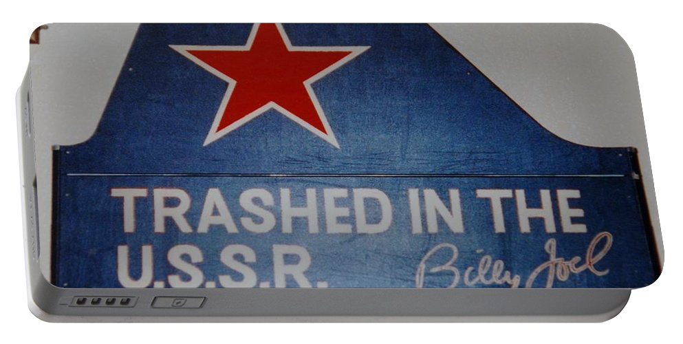 Billy Joel Portable Battery Charger featuring the photograph Trashed In The U S S R by Rob Hans