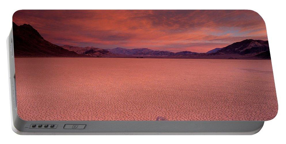 Race Track Valley Portable Battery Charger featuring the photograph Traveling Stone by Leland D Howard