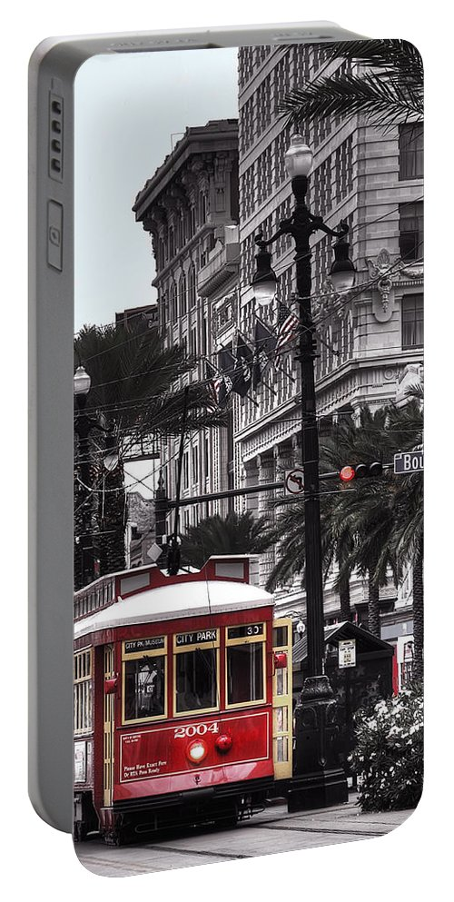 Nola Portable Battery Charger featuring the photograph Trolley On Bourbon And Canal by Tammy Wetzel