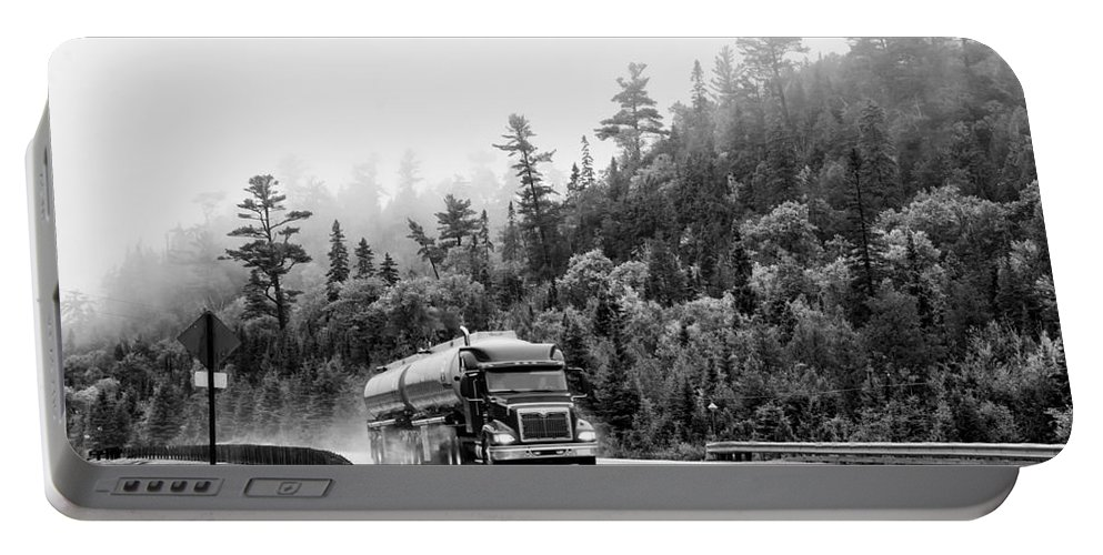 Truck Portable Battery Charger featuring the photograph Truck On Foggy Highway by Les Palenik