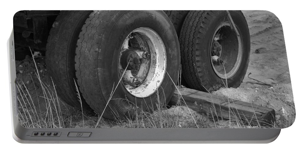 Black And White Portable Battery Charger featuring the photograph Truck Tires by Rob Hans