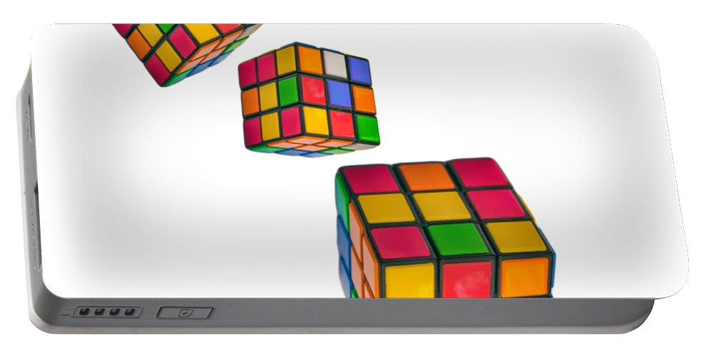Cube Portable Battery Charger featuring the photograph Tumbling Cubes by Martin Newman