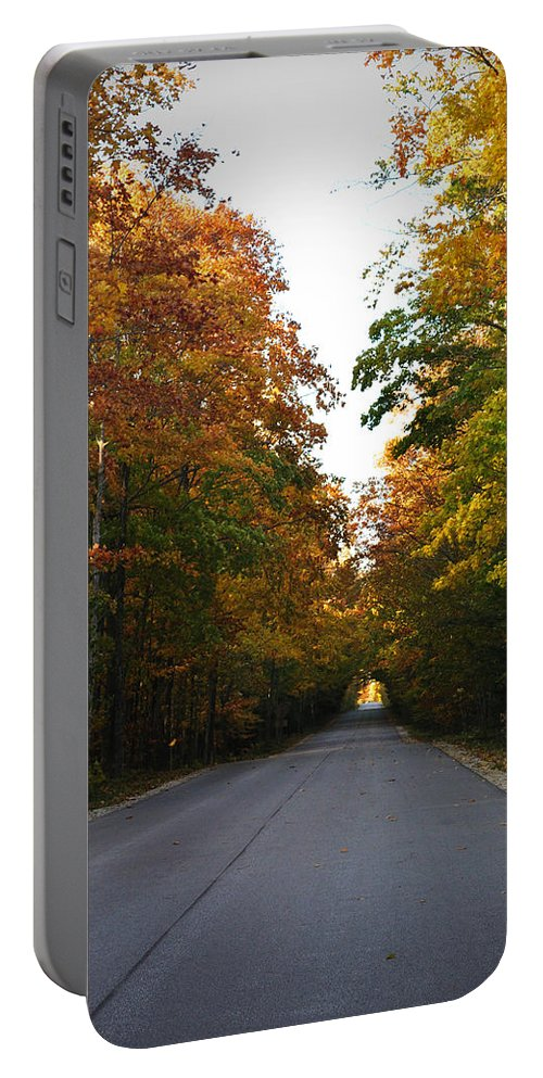 Fall Portable Battery Charger featuring the photograph Tunnel by Tim Nyberg