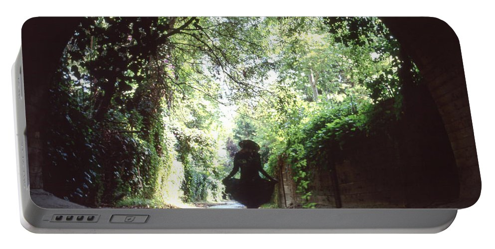 Peaceful Portable Battery Charger featuring the photograph Tunnel Walk by Steve Williams
