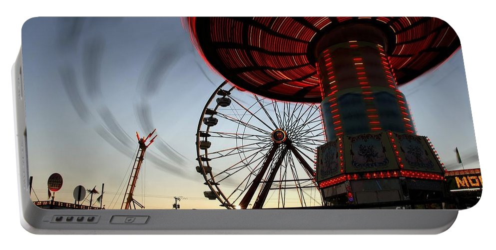 Fair Portable Battery Charger featuring the photograph Twirling Away by David Lee Thompson