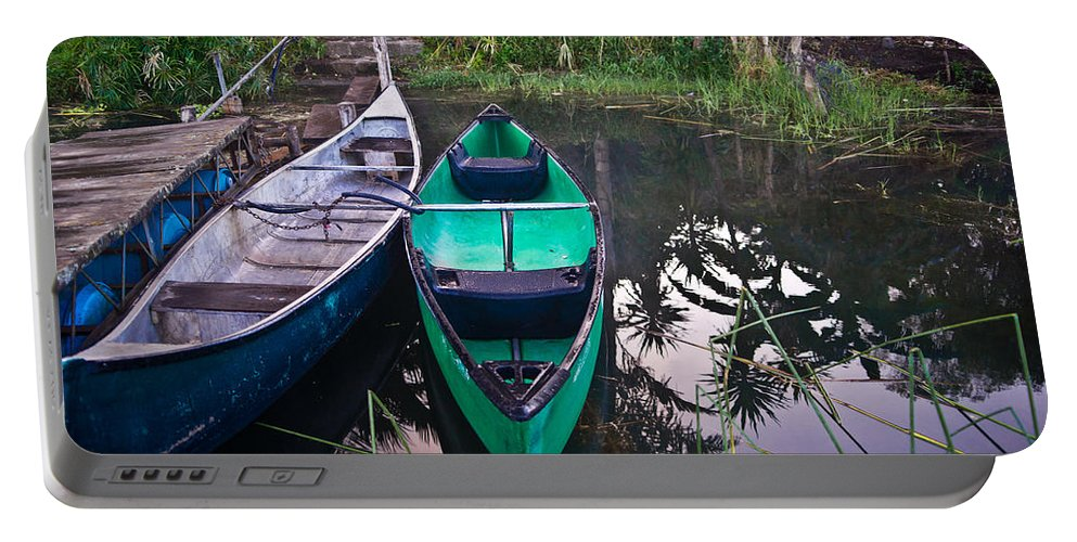 Canoe Portable Battery Charger featuring the photograph Two Canoes by Douglas Barnett
