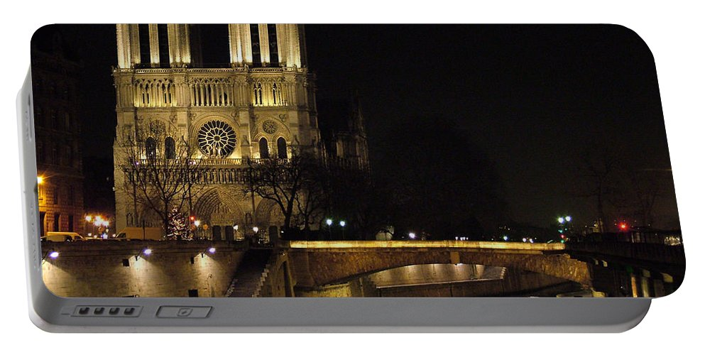 Two Portable Battery Charger featuring the photograph Two Towers Of Notre Dame by Donna Corless