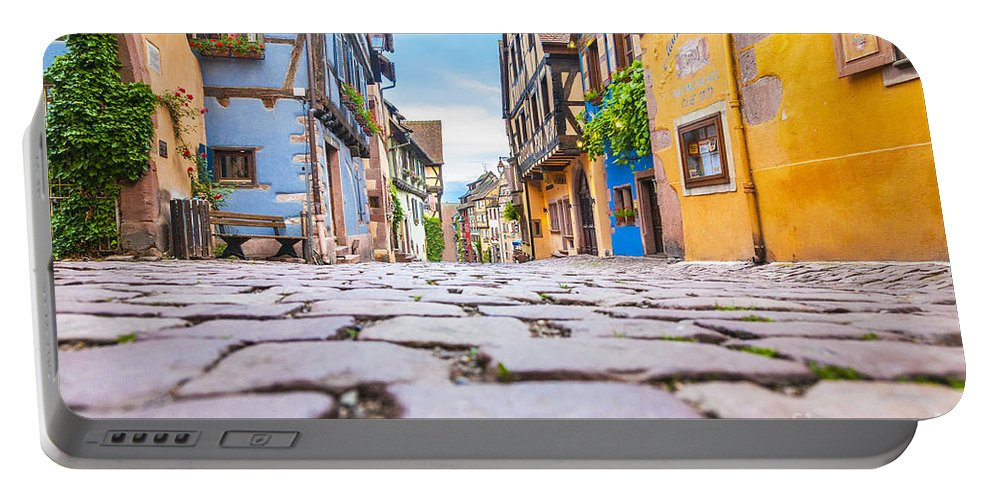 Alsace Portable Battery Charger featuring the photograph half-timbered houses, Riquewihr, Alsace, France  by Marco Arduino