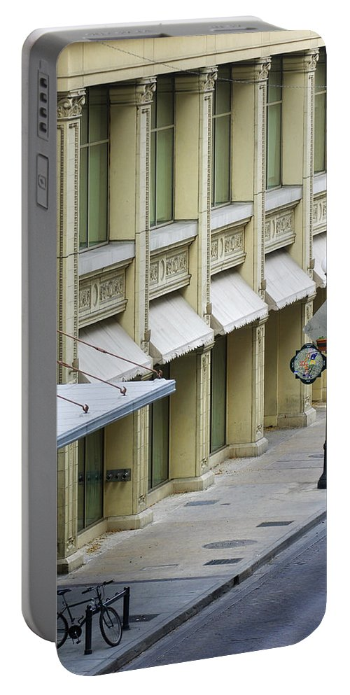 Street Scene Portable Battery Charger featuring the photograph Uno Cycle by Jill Reger