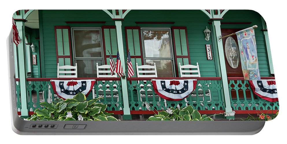 American Flag Portable Battery Charger featuring the photograph Victorian House And Garden. by John Greim