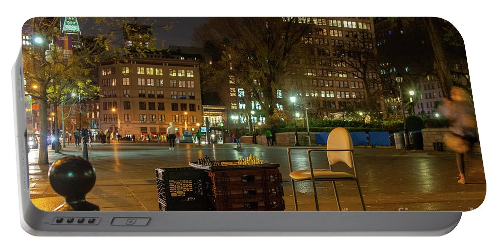Manhattan Portable Battery Charger featuring the photograph View Of Chess Board In The Middle Of Busy Sidewalk At Night by PorqueNo Studios