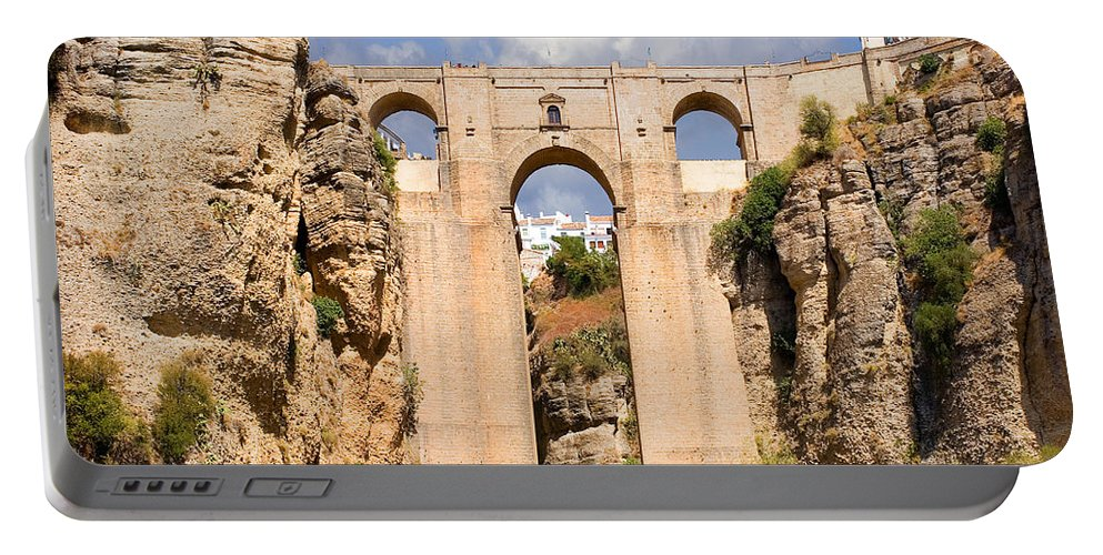 Ronda Portable Battery Charger featuring the photograph View Of The Tajo De Ronda And The Puente Nuevo Bridge From Across The Valley by Mal Bray